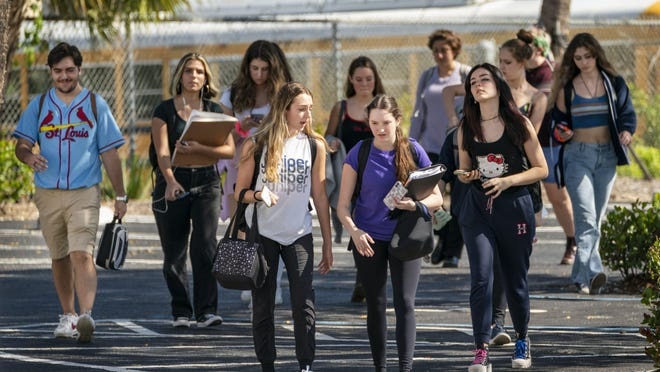Dreyfoos School of the Arts students leave school walk on March, 13, the last day of in-person classes in Palm Beach County public schools.