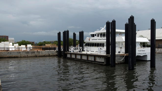 The Turtle Runner ferry is tied up at the dock at the Commendencia slip in downtown Pensacola on Tuesday, June 12, 2018.