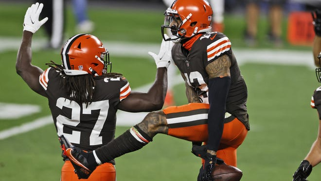 Cleveland Browns wide receiver Odell Beckham Jr., right, celebrates a 43-yard touchdown with running back Kareem Hunt on Thursday in Cleveland.