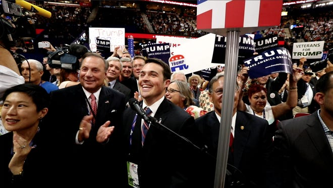 Governor Chris Christie's son Andrew (center) casts New Jersey votes for Donald Trump during the roll call at teh Republican National Convention in Cleveland Tuesday July 19, 2016.