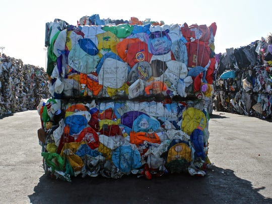 A mountain of smashed detergent bottles lies outside the Material Recovery Facility in Fontana, on July 28, 2015. Everything recoverable gets packed into trucks, sold and shipped out to manufacturers.