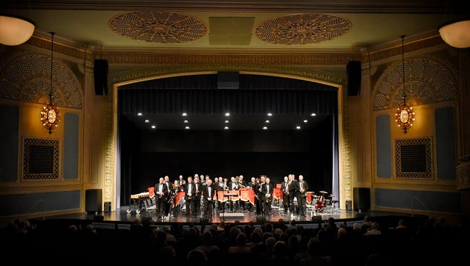 The Lake Wobegon Brass Band members stand during their performance Sunday at the Paramount Theatre in St. Cloud. The band is a traditional British brass band ensemble.