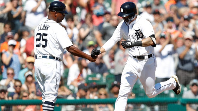 Detroit Tigers right fielder Nicholas Castellanos (9) celebrates with third base coach Dave Clark (25) as he rounds the bases after hitting a solo home run during the first against the Texas Rangers inning at Comerica Park on July 7, 2018.