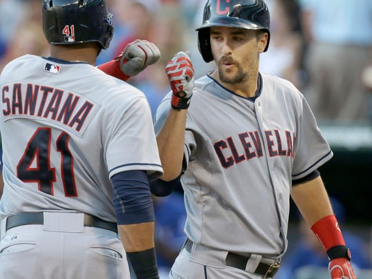 Cleveland Indians Lonnie Chisenhall, right, gets a congrats at home plate from teammate Carlos Santana (41) after Chisenhal's two run home in the second inning of a baseball game against the Texas Rangers in Arlington, Texas, Monday, June 9, 2014. (AP Photo/LM Otero)