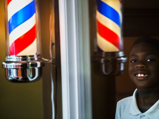 """August 24, 2017 -  Quinelius """"Scooby Cutz Jr."""" Jones, 8, has been influenced by his father and barber, Quintin """"Scooby Cutz"""" Patrick, to follow him in the trade. The young barber has been cutting and styling hair for years. Jones and Patrick will fly out to Los Angeles to appear on the Steve Harvey Show and talk about cutting hair."""