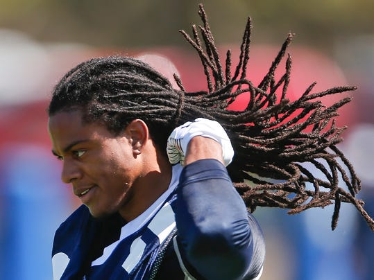 San Diego Chargers cornerback Jason Verrett, the team's first round draft choice,  adjust his hair at a NFL football training camp Thursday, July 24, 2014, in San Diego.  (AP Photo/Lenny Ignelzi)