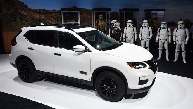 Storm Troopers stand at attention as the 2017 Nissan Rogue One Star Wars Limited Edition is unveiled at a press conference during media preview days ahead of the public opening of the Los Angeles Auto Show