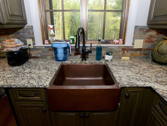 A farmhouse sink is a big investment, but will stand