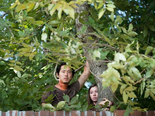 Steven Yeun as Glenn Rhee and Katelyn Nacon as Enid