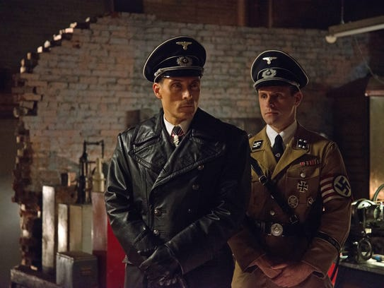 John Smith (Rufus Sewell), at left, and Erich Raeder