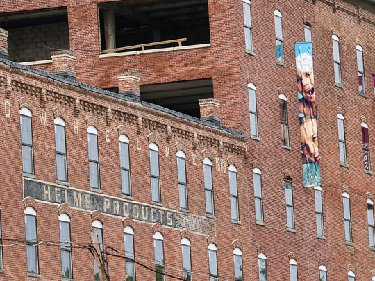 The former Helmetta Snuff factory is being converted to apartments by the Kaplan Companies. Helmetta mayor Nancy Martin takes a tour on July 2, 2015.