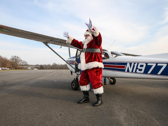Santa (Bruce Wessel of Manville) arrives at Central Jersey Regional Airport in Hillsborough on Dec. 13, sponsored by TriState Aviation, the flight school at the airport, along with Hillsborough Rotary Club.