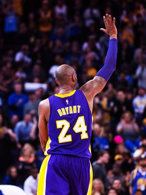 Kobe Bryant waves to the crowd Jan. 14, 2016, in his final game at Oracle Arena in Oakland against the Warriors.
