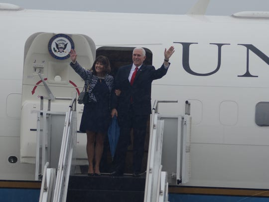 Vice President Mike Pence and his wife, Karen, emerge from the plane on Saturday.