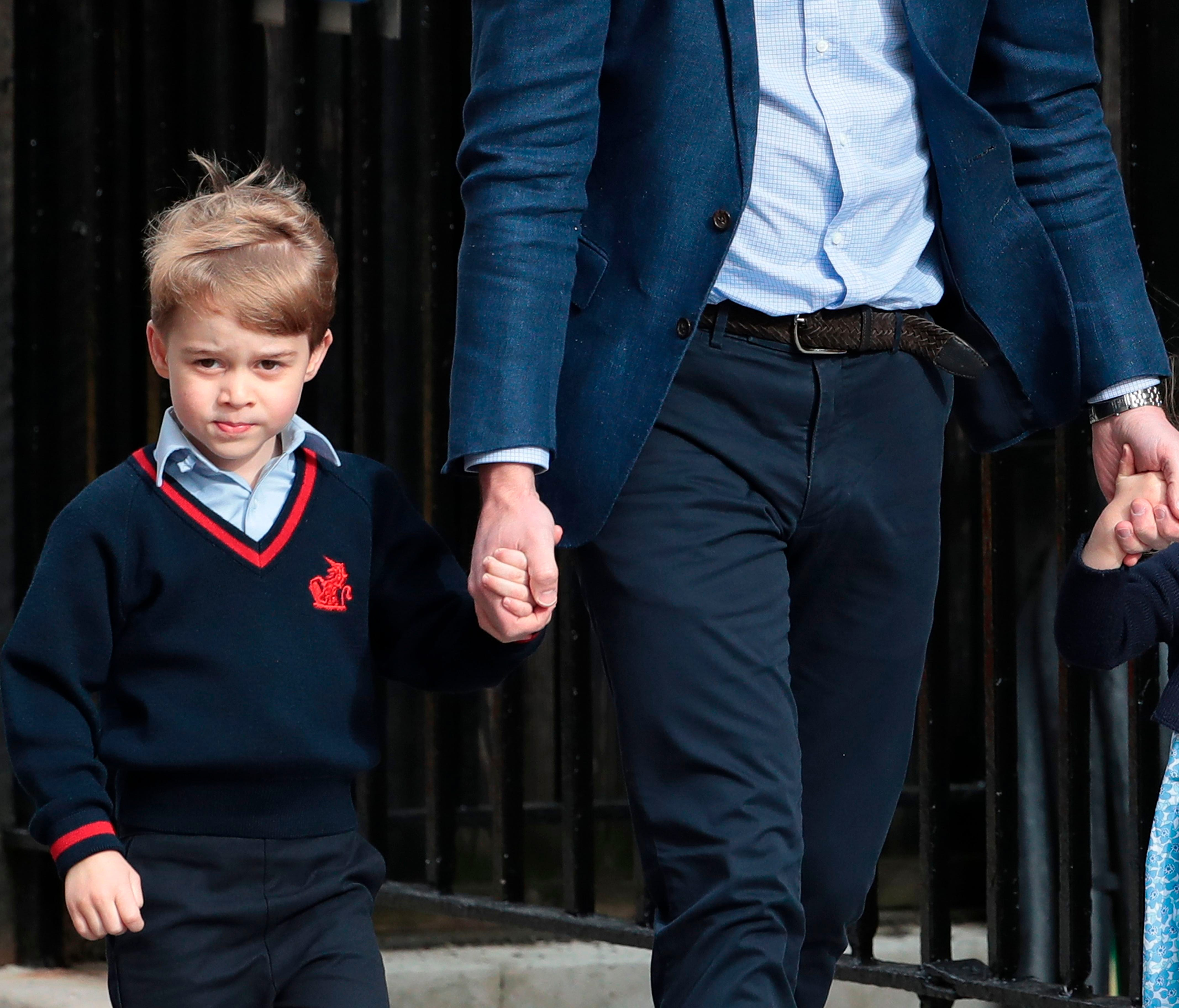 Princess Charlotte of Cambridge waves at the media as she is led in with her brother Prince George of Cambridge by their father Britain's Prince William, Duke of Cambridge, at the Lindo Wing of St Mary's Hospital in central London, on April 23, 2018.