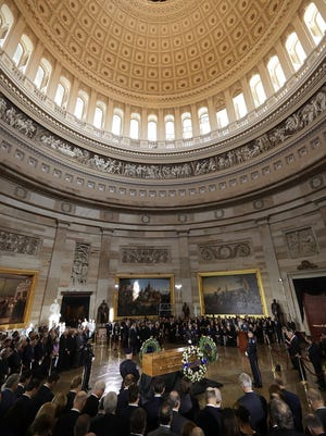 Christian evangelist and Southern Baptist minister Billy Graham's casket lies in honor during a ceremony attended by members of Congress and the Trump administration in the Rotunda of the U.S. Capitol in Washington, D.C., on Feb. 28, 2018.