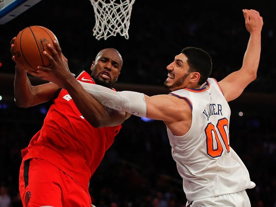 Toronto Raptors forward Serge Ibaka (9) and New York Knicks center Enes Kanter (00) battle for a rebound during the fourth quarter of an NBA basketball game, Wednesday, Nov. 22, 2017, in New York. The Knicks won 108-100. (AP Photo/Julie Jacobson)