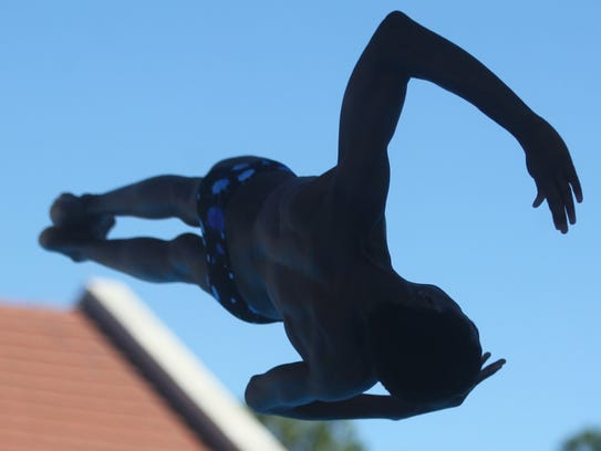 Leon's Taj Cole dives during Wednesday's Region 1-3A