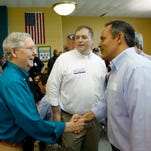 Senator Mitch McConnell and  gubernatorial candidate Matt Bevins shake hands at the Republican breakfast in Graves County.  Aug. 1, 2015