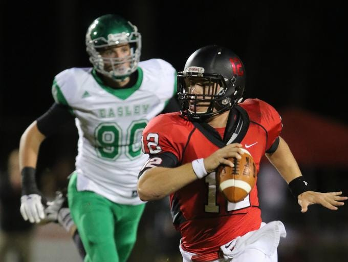 Hillcrest's Collin Sneed(12) scrambles in the backfield from Easley's Austin Morgan (90) for a first down.
