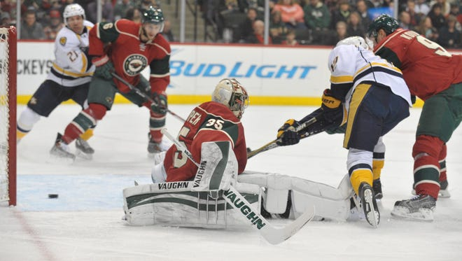 Nashville's Calle Jarnkrok (19) scores on Minnesota goalie Darcy Kuemper (35) during the first period.
