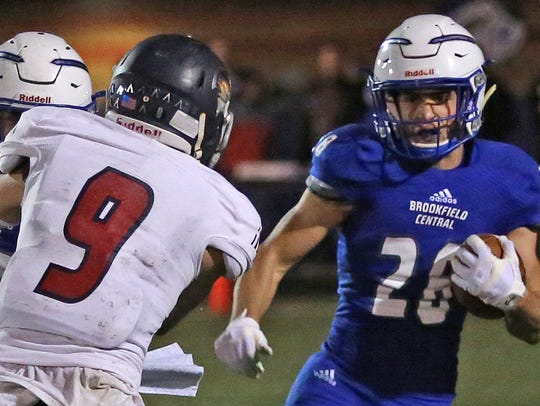 Brookfield Central running back Zach Heckman tries