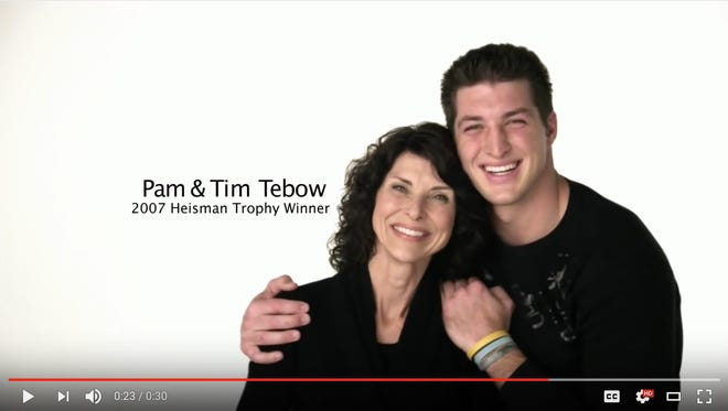 Tim Tebow and his mother, Pam Tebow, in a Focus on the Family ad.