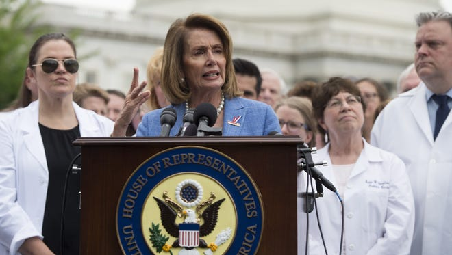 House Minority Leader Nancy Pelosi speaks alongside doctors, nurses and health care providers against the Republican health care legislation during a rally on Capitol Hill on June 22, 2017.