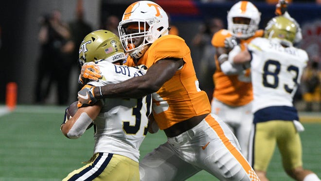 Tennessee linebacker Daniel Bituli (35) tackles Georgia Tech running back Nathan Cottrell (31) during first half action at the Chick-fil-A Kickoff Game Monday, Sep. 4, 2017 against Georgia Tech in Atlanta, Ga.
