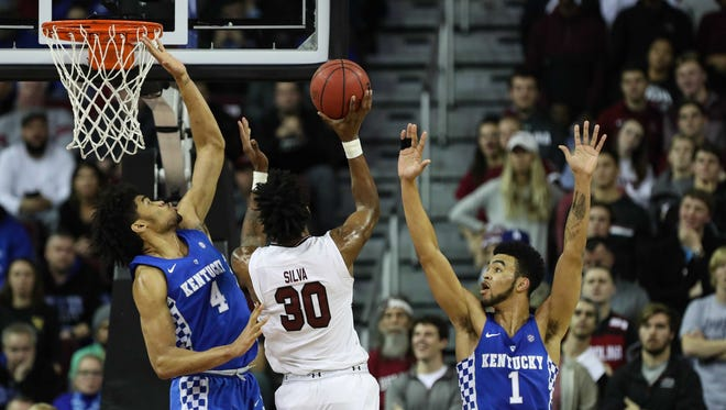 South Carolina Gamecocks forward Chris Silva (30) goes up for a shot covered by Kentucky Wildcats forward Nick Richards (4) during the first half at Colonial Life Arena in Columbia, South Carolina, on Tuesday, Jan. 16, 2018.