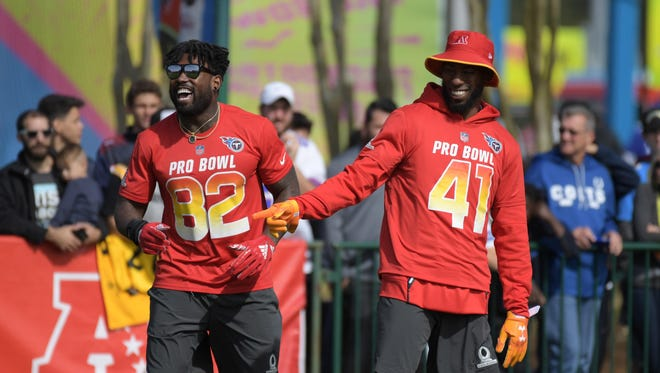 Tennessee Titans tight end Delanie Walker (84) and special teams player Brynden Trawick (41) react during AFC practice for the 2018 Pro Bowl at ESPN Wide World of Sports.