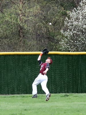 Edward Abplanalp making an over-the-head catch for Bloomfield.