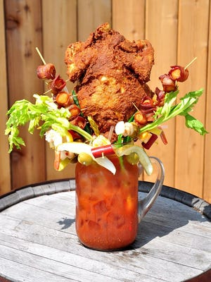 In Milwaukee and three other Wisconsin cities, Sobelman's Pub & Grill serves a full menu of over-the-top bloody Marys (made with Tito's Vodka), like this Chicken Fried Bloody Mary with a full chicken on top.
