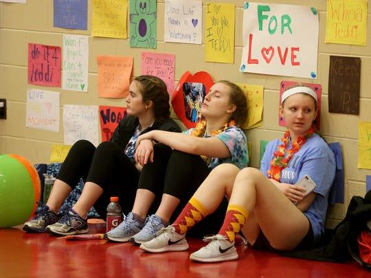 Aubrey Blanthorn, Riley Smith and McKenzie Lynn take a break during the Teddi Dance for Love.