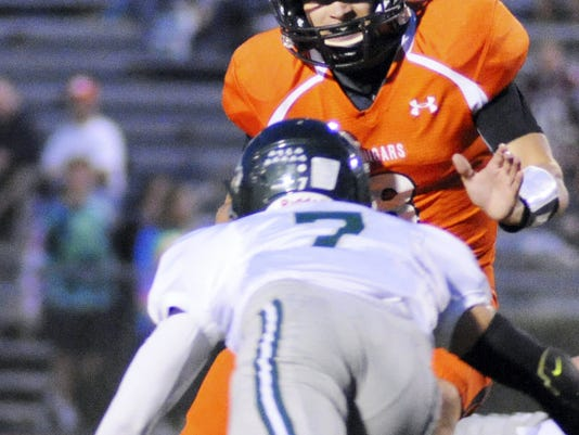 Palmyra's Tyler Gallagher throws a stiff arm in this file photo against Trinity's Casey Boguski during the game on Friday, September 25, 2015.