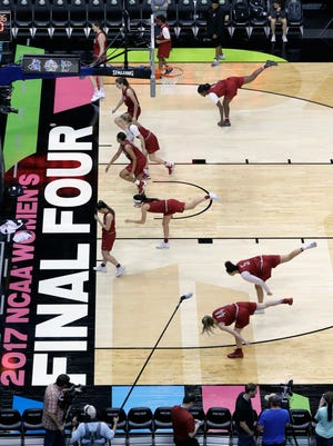 Stanford players stretch during practice for the women's NCAA Final Four college basketball tournament.