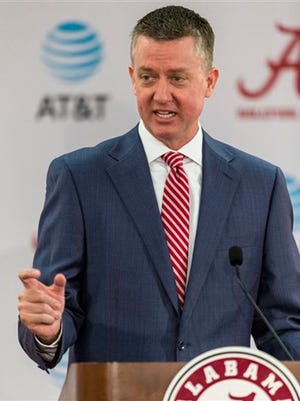 FILE - In this June 5, 2017, file photo, Alabama athletics director Greg Byrne speaks at a news conference in Tuscaloosa, Ala. On March 1, 2017, after stints as AD at Mississippi State and Arizona, the 45-year-old Byrne took over at Alabama and became NCAA college football head coach Nick Saban's boss. (Vasha Hunt/Alabama Media Group via AP, File)