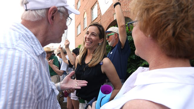Mikie Sherrill, a former Navy pilot who plans to run in the Democratic primary in the 11th congressional district next year talks with members of the grassroots group 'NJ 11th for Change' at the Morristown office of Congressman Rodney Frelinghuysen. The GOP lawmaker is facing an ethics complaint after targeting a local liberal activist through a fundraising letter to her employer. May 19, 2017, Morristown, NJ.