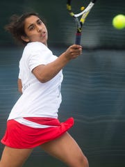 CVU #1 seed Kathy Joseph smashes a forehand return against South Burlington's Lanka Badnjevic during their girl's tennis championship match last year.
