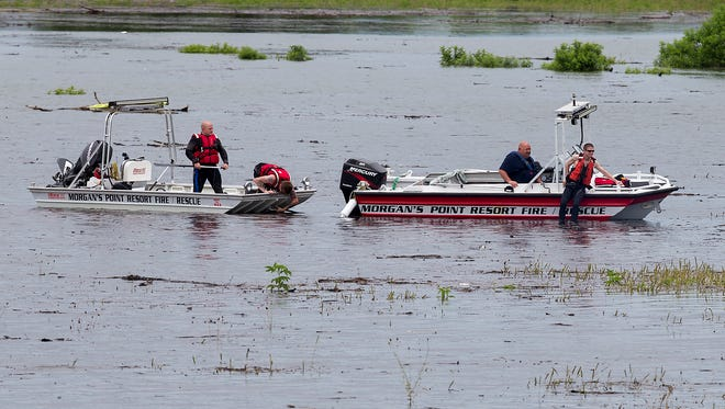 Morgan's Point Resort Fire and Rescue work on Lake Belton near the scene of the accident at Fort Hood.