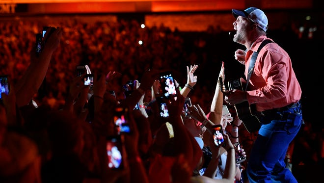 Garth Brooks performs at Nissan Stadium on the first day of CMA Fest 2017, on Thursday, June 8, 2017, in Nashville.