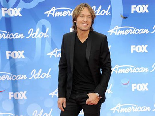 "Keith Urban, seen at the 2013 ""American Idol"" finale,"