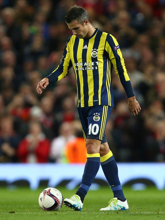 FILE - In this file photo dated Thursday, Oct. 20, 2016, Fenerbahce's Robin van Persie looks down during the game against Manchester United during the Europa League Group A soccer match at Old Trafford stadium in Manchester, England. Netherlands coach Dick Advocaat has recalled veteran striker Robin van Persie to the national team Friday Aug. 25, 2017, ahead of upcoming crucial World Cup qualifiers against France and Bulgaria. (AP Photo/Dave Thompson, FILE)