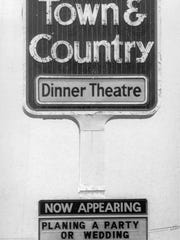 July 1977: Town and Country Dinner Theater sign  advertises
