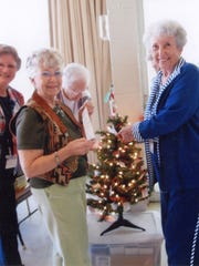 Three Rivers Woman's Club members Gaynor McKee and Bettie Powert pull names of local children from a Christmas tree in 2011. The local food pantry provides the names of children in need.
