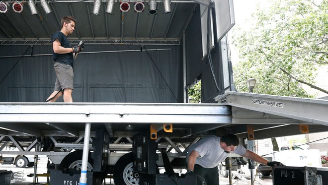 Chris Verschneider bellow and Scott Long with Audio Images help setup the The City of Rochester Jazz Street Stage on Gibbs Street during the day before the start of the Xerox Rochester International Jazz Festival.