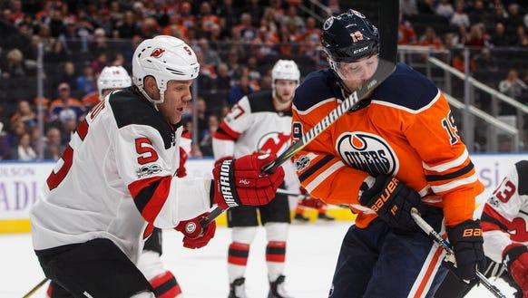 New Jersey Devils' Dalton Prout (5) hits Edmonton Oilers'
