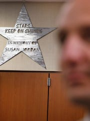 A shining star remembers the late Amy Beverland Elementary School principal in the office  Tuesday, Aug. 23, 2016.  Susan Jordan was killed in a tragic accident when a bus jumped the curb and hit her during school dismissal in January 2016. Jered Pennington, right, has been named as the new principal at the school.
