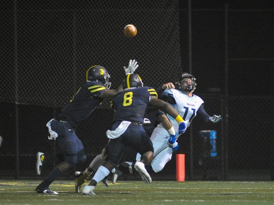 Northpoint Lausanne Lausanna Collegiate linebacker Nyle Love (8) forces a pass from Northpoint Christian  quarter back Arlie Gagne (11) during second half action of their Division II-AA playoff game, Friday, November 3, 2017.