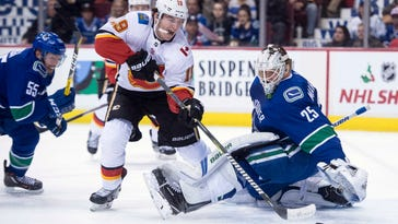 Giordano, Bennett lead Flames to 6-1 win over Canucks